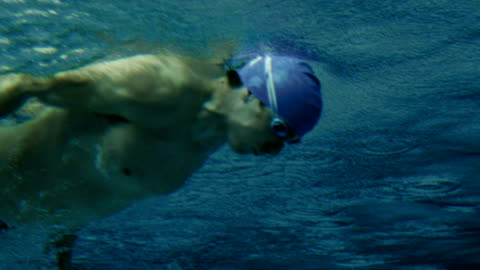 underwater shot of a swimmer - swimming goggles stock videos & royalty-free footage