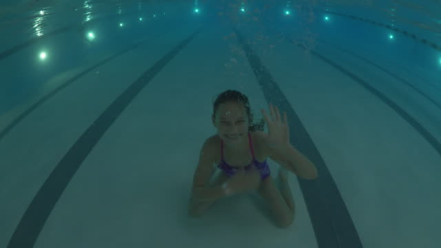 underwater shot of girl submerging in swimming pool and waving / lehi, utah, united states - lehi stock videos & royalty-free footage