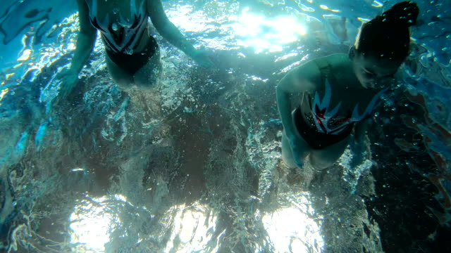 underwater swimming athletes choreography practice - coordination stock videos & royalty-free footage