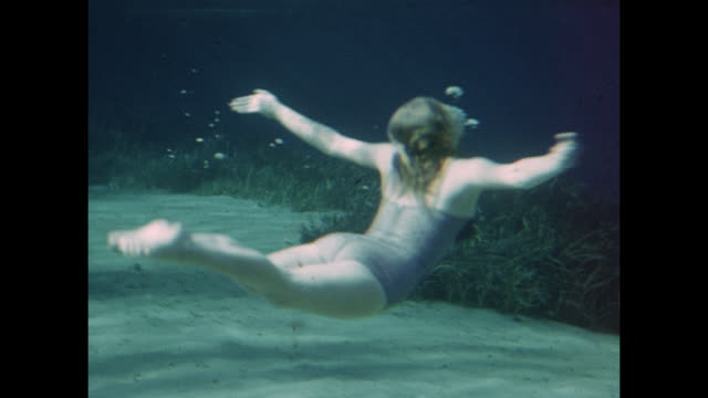 1954 home movie underwater swimming show in tank / united states  - swimwear videos stock videos and b-roll footage