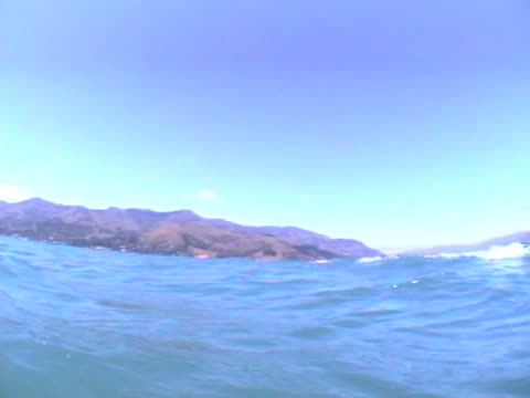 underwater to topside scenic - pov as break surface when swimming. - akaroa stock videos & royalty-free footage