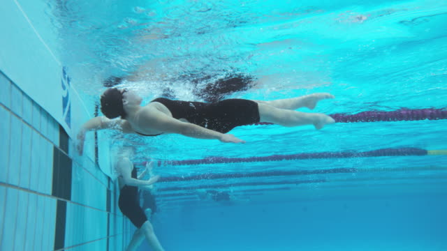 Underwater view of female backstroke style competition finish