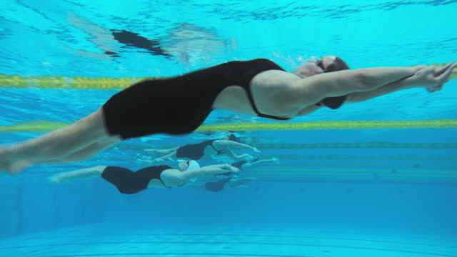 underwater view of female swimmers' backstroke start - backstroke stock videos & royalty-free footage
