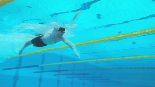 underwater view of male swimmer doing a dive start - one man only stock videos & royalty-free footage