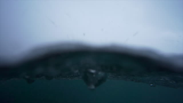 underwater view of rain hitting ocean sea and waves waves. - slow motion - rain stock videos & royalty-free footage