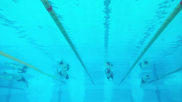 Underwater view of swimmers at male freestyle competition