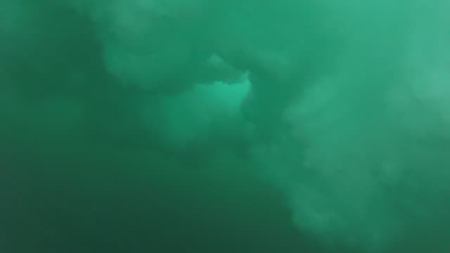 underwater view of turbulent waves breaking at the beach. - slow motion - camcorder stock videos & royalty-free footage