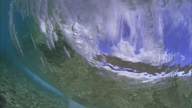 SLO MO POV CU Underwater view of wave crashing / Moorea, Tahiti, French Polynesia