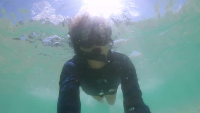 underwater young man  snorkeling having fun in the sea - swimming goggles stock videos & royalty-free footage