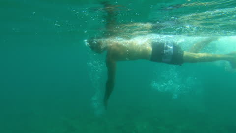 underwater young man swimming goggles having fun in the sea - swimming goggles stock videos & royalty-free footage