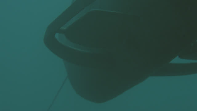 underwater-sub moving down-cables visible - undersea video stock e b–roll