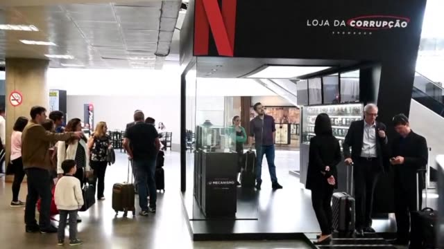 underwear with money pockets fashionable ankle monitor covers a netflix shop fictitiously selling items for corrupt operators in brasilia's airport... - toccare con un dito video stock e b–roll