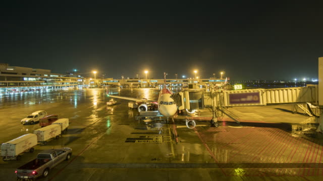 Undocking aircraft at night time lapse