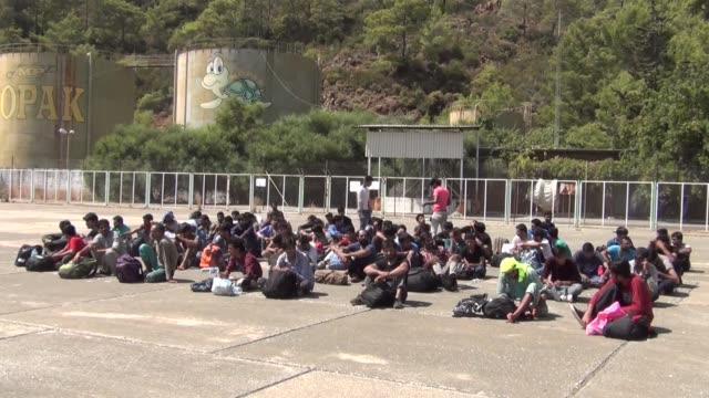 73 undocumented migrants held in coastal fethiye district of turkey's southwestern mugla province as they attempted to illegally cross into greece on... - mugla province stock videos and b-roll footage