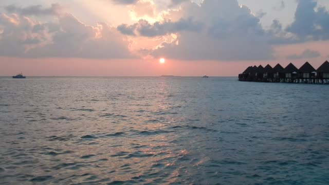 Unedited Footage of Maldivian Sunset and Overwater Bungalows