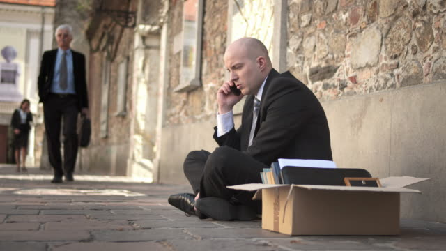 hd dolly: unemployed businessman on the phone - unemployment stock videos and b-roll footage