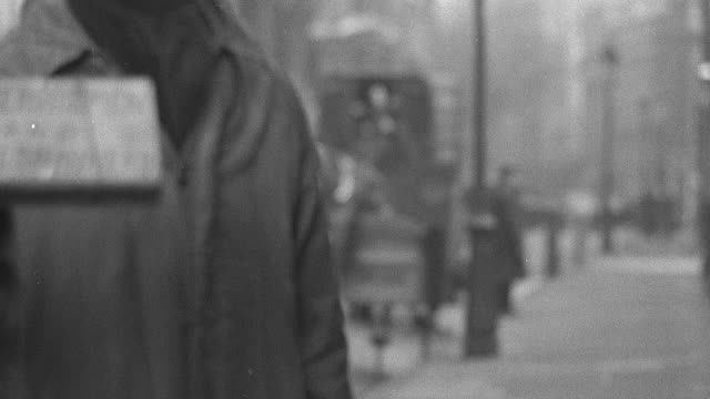 stockvideo's en b-roll-footage met montage unemployed men walking and begging, and abandoned mines and factories / united kingdom - 1937