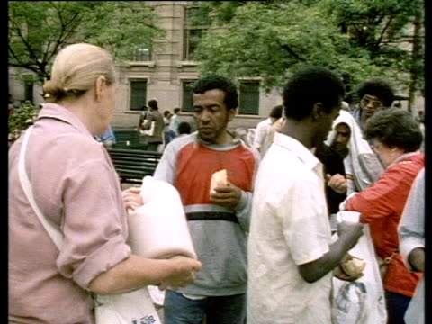 unemployed people queue for food hand outs cathedral square - unemployment stock videos and b-roll footage