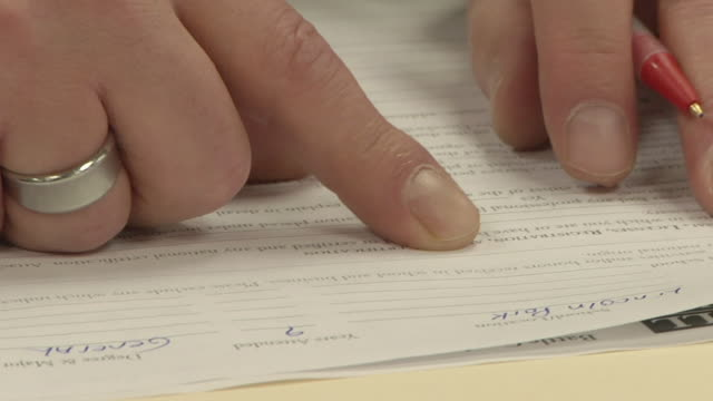 ECU ZO MS Unemployed worker filling out paperwork and applications at Michigan Works job center, Jackson, Michigan, USA