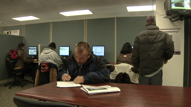 MS PAN Unemployed worker filling out paperwork and applications at Michigan Works job center, Jackson, Michigan, USA