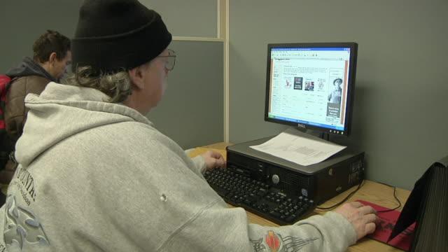 cu unemployed worker using computer at michigan works job center, jackson, michigan, usa - job centre stock videos & royalty-free footage