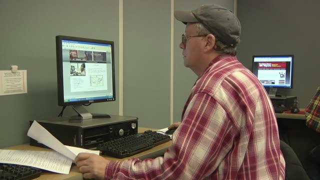MS ZI ZO Unemployed worker using computer at Michigan Works job center, Jackson, Michigan, USA