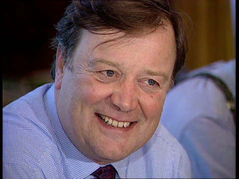 unemployment fall itn lib treasury cms kenneth clarke mp smiling cms eddie george smiling tgv both at meeting table with others - kenneth clarke stock-videos und b-roll-filmmaterial