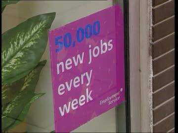 vidéos et rushes de unemployment falls below one million; england: ext cms sign 'job centre employment service' lms job centre office sign in window of job centre... - chômage