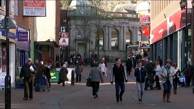unemployment falls to seven year low england staffordshire tamworth ext people along on high street - low unemployment stock videos & royalty-free footage
