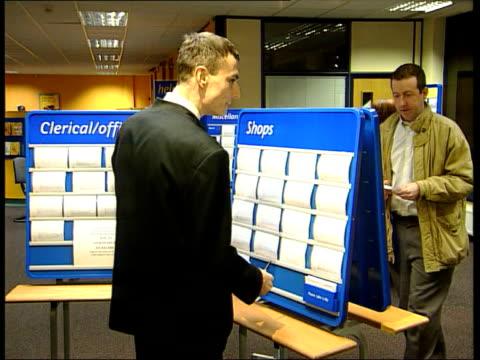vidéos et rushes de unemployment figures down/jobs threatened; lib england: london int people in job centre looking at cards - chômage