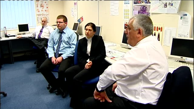 unemployment figures fall; england: northamptonshire: corby int man talking to men at tables at employment training course men sat listening people... - northamptonshire stock-videos und b-roll-filmmaterial