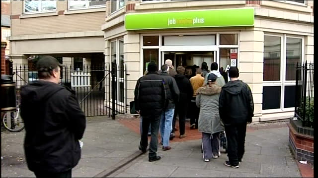 unemployment figures rise ext people queueing outside job centre - unemployment queue stock videos & royalty-free footage