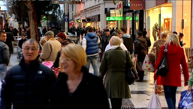 stockvideo's en b-roll-footage met gvs cardiff shoppers low angle shots of shoppers about / crowded street with fairground in background / more gvs with lightedt shop windows some... - bare tree