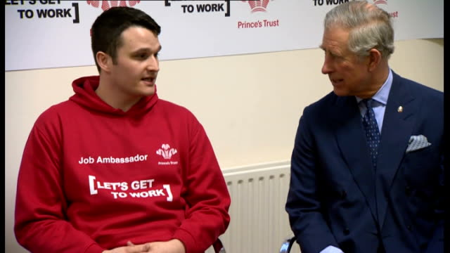 prince charles visits prince's trust hq; england: london: int prince charles, prince of wales, cahtting with staff in reception area/ various shtos... - プリンスズトラスト点の映像素材/bロール