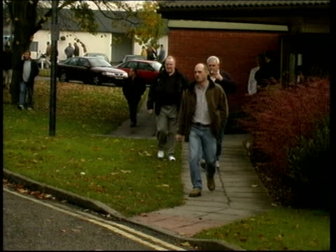 vídeos de stock, filmes e b-roll de midlands wolverhampton goodyear workers driving away from tyre factory workers walking away from plant vox pops sot london int man using 'jobpoint'... - tyre