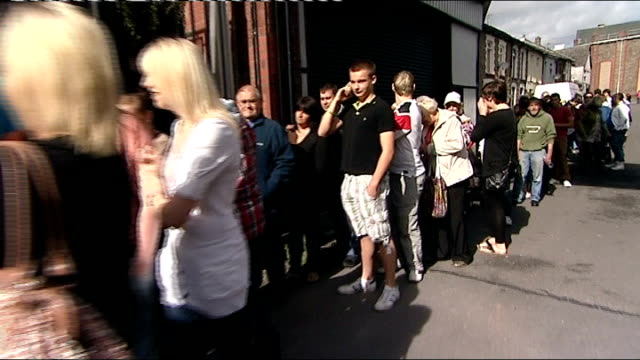 unemployment rises to two and a half million people wales rhondda cynon taf pontypridd ext track along queues of people waiting to enter jobs fair - unemployment queue stock videos & royalty-free footage