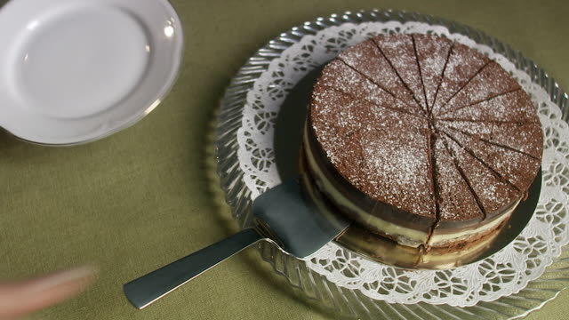 unequal division of a birthday cake, sweden. - slice stock videos and b-roll footage