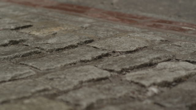 uneven bricks in brick road - uneven stock videos & royalty-free footage