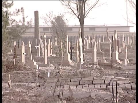 a uneven stone path runs through a cemetery - ムラがある点の映像素材/bロール