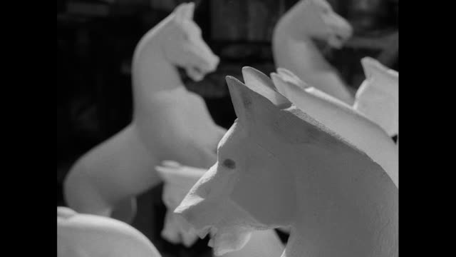 unfinished rocking horses in factory; 1956 - 1956 stock-videos und b-roll-filmmaterial