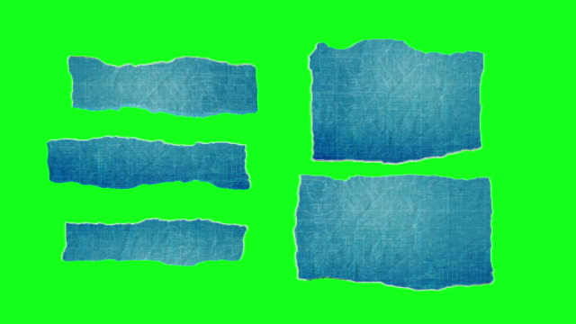 unfolding blueprint paper pieces on chroma key green screen - folded stock videos and b-roll footage