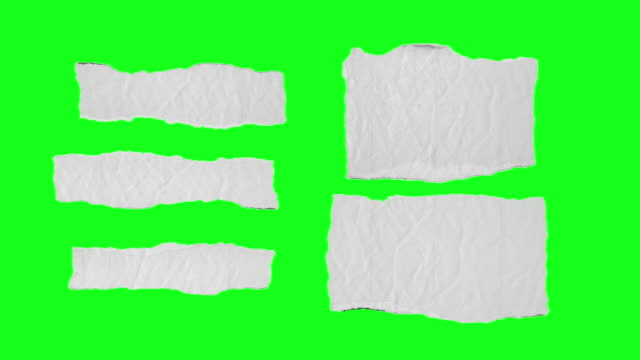 unfolding paper pieces on chroma key green screen - folded stock videos & royalty-free footage