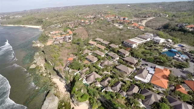 """ungasan is """"a new frontier"""" in bali, with newly developed real estates like hotels and villas perched in the cliff, facing the indian ocean. - appollaiarsi video stock e b–roll"""