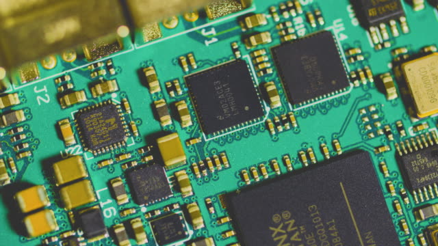 Ungraded anticlockwise revolving closeup shot of a circuit board