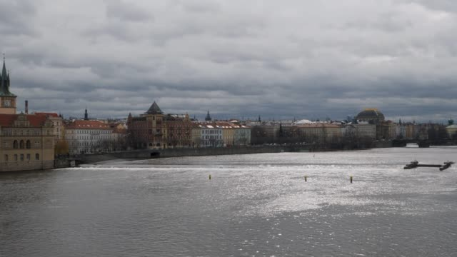 ungraded pan of the prague skyline taken from charles bridge - prague stock videos & royalty-free footage