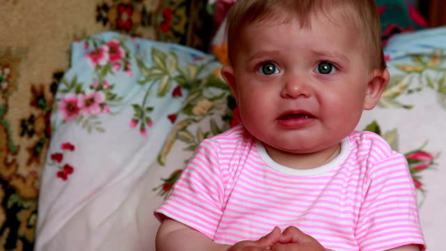 unhappy baby looking at camera - child abuse stock videos & royalty-free footage