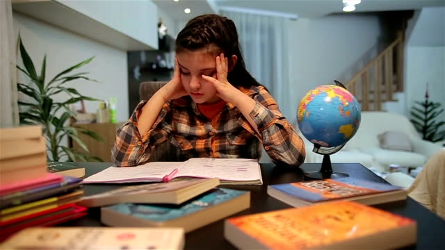 unhappy child working on hard homework at home alone - youth culture stock videos & royalty-free footage