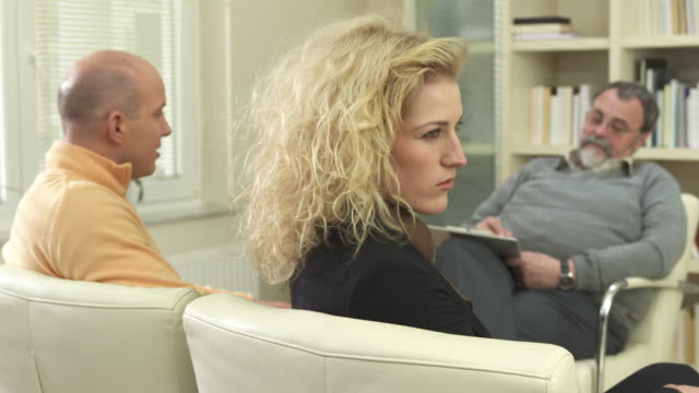 hd: unhappy couple at the counselor - psychiatrist's couch stock videos and b-roll footage