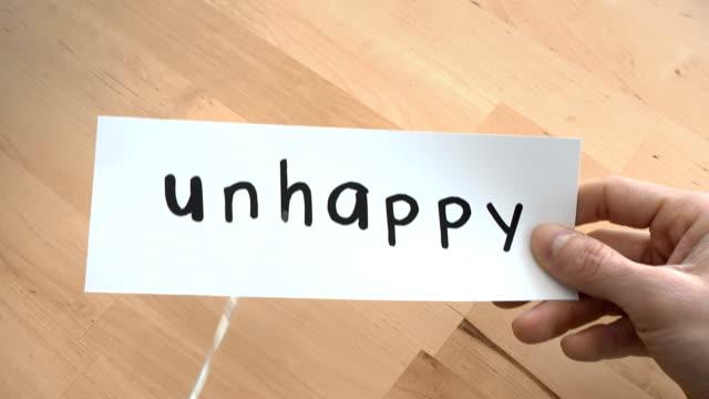 vídeos de stock e filmes b-roll de unhappy to happy by scissors - cut video transition