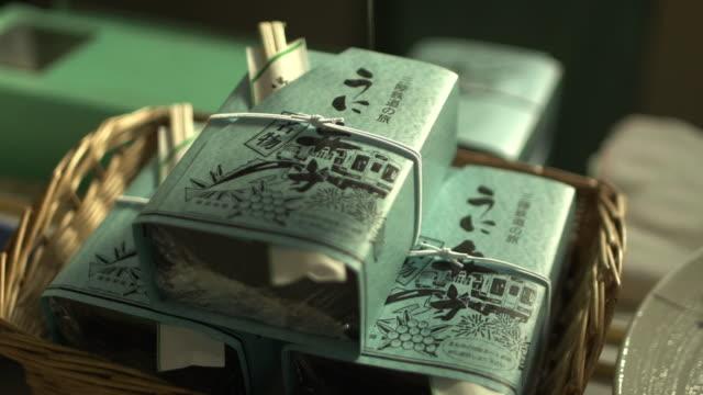 uni bento, railway boxed meal, iwate, japan - 包装紙点の映像素材/bロール